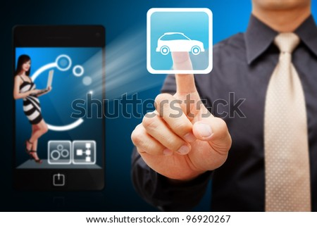 Business man touch the Car icon from mobile phone - stock photo