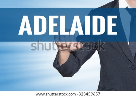 Business man touching Adelaide word on blue virtual screen - stock photo