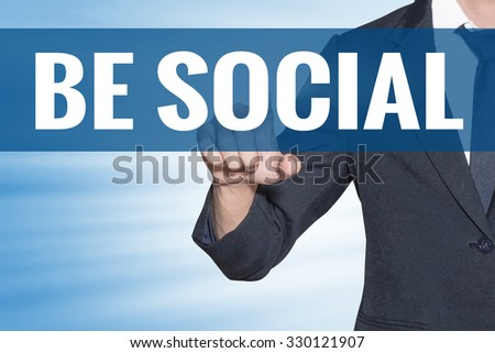 Business man touching Be Social word on blue virtual screen - stock photo