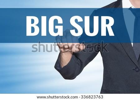 Business man touching Big Sur word on blue virtual screen - stock photo
