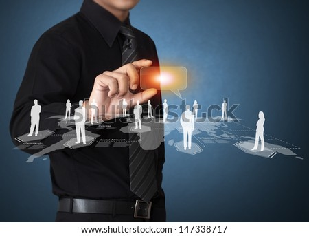 Business man touching virtual icon of social network - stock photo