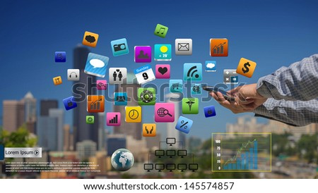 Business man use mobile phone with colorful application icons - stock photo