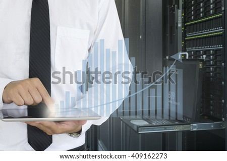 Business man use tablet for analyze in data center - stock photo