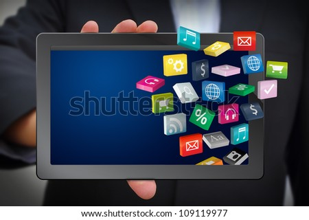 Business man use tablet pc with cloud of colorful application - stock photo