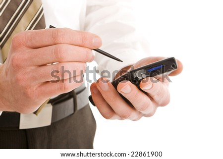 Business man using a pda isolated on white - stock photo