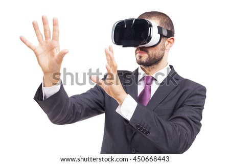 Business man using a VR headset, isolated on white background - stock photo