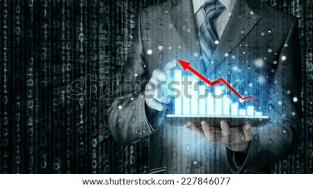 business man using tablet computer to work with financial data - stock photo