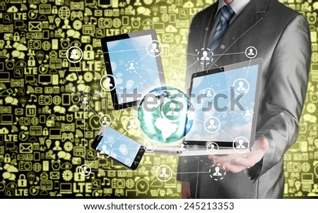Business man using tablet PC and smartphone social connection - stock photo
