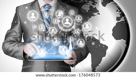 Business man using tablet PC. conceptual image of social connection - stock photo