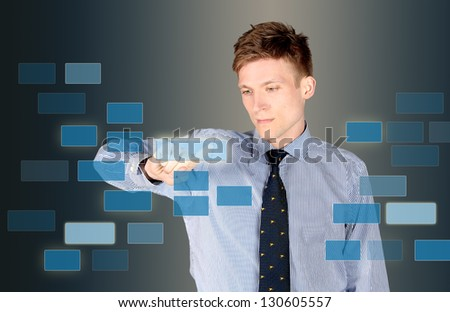 Business man using touchscreen buttons - stock photo