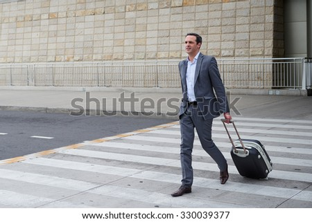 Business man walking at the airport - stock photo