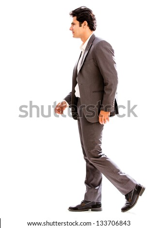 Business man walking to the side - isolated over a white background - stock photo