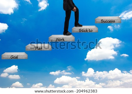 business man walking up stepping ladder on blue sky and word goal plan work stick to success idea concept step by step for success and growth business - stock photo