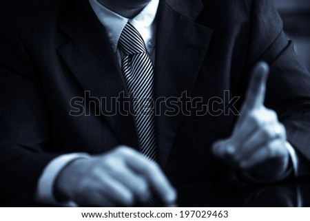 Business man wearing a suit with tie. Detail on the tie. - stock photo