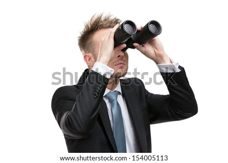 Business man wearing suit with blue tie hands binoculars, isolated - stock photo