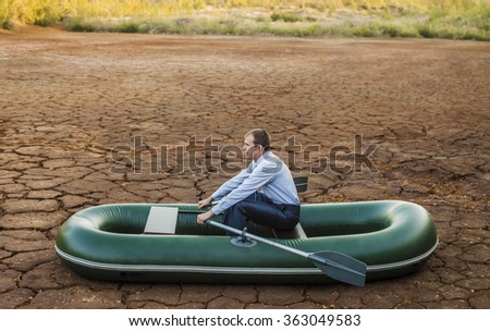 Business man will rows home for shore in paddle powered row boat businessman in boat rocks looks bright future symbol crisis stagnation losses braking environmental disaster water scarcity drought - stock photo