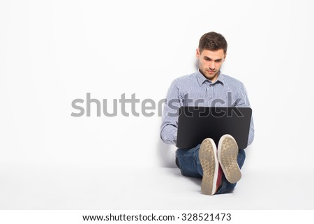 Business man with a laptop on a white background - stock photo