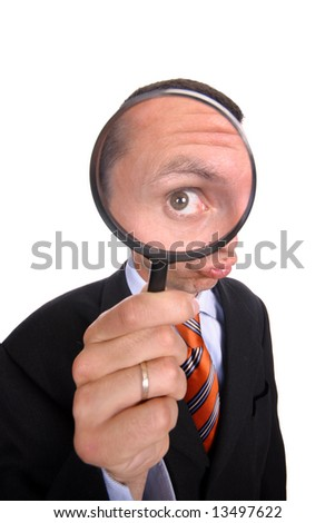 business man with a loupe over white background - stock photo