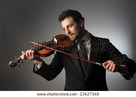 business man with a violin - stock photo