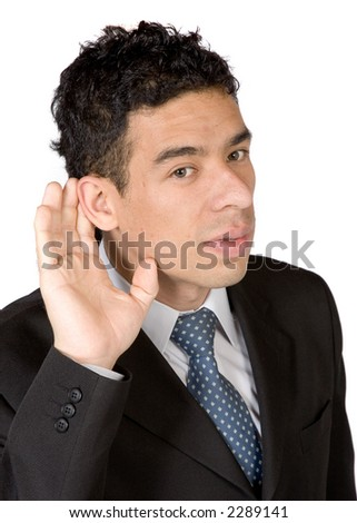 business man with ahnd on ear - cant hear you concept - stock photo