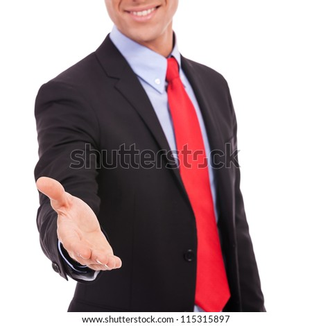 business man with an open hand ready to seal a deal with a handshake - stock photo