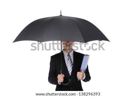 Business Man with an umbrella - stock photo