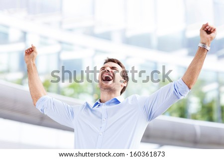Business man with arms raised - stock photo