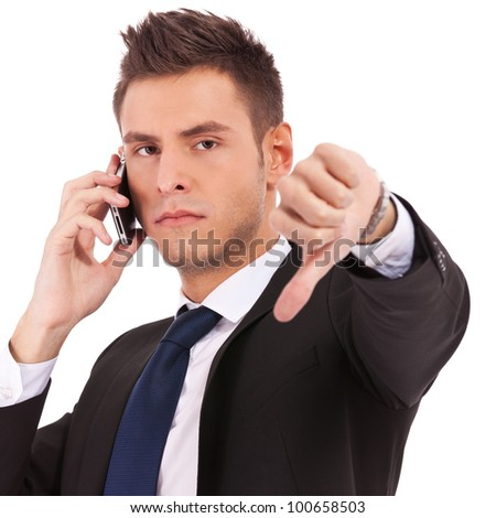 Business man with bad news on his cell phone disapproving . negative answer - stock photo