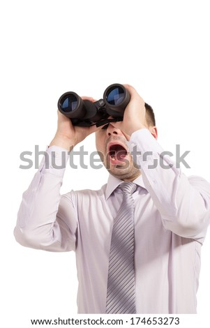 Business man with binoculars. Young businessman in shirt and tie looking through binoculars expressing emotion surprise. Man shouts something seeing through binoculars concept market research. - stock photo