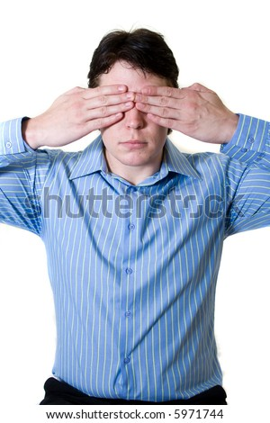 Business man with blue shirt holding both hands in front of his eyes to prevent him from seeing - stock photo
