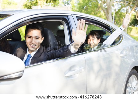 business man with daughter driving car go to work and school - stock photo