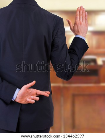 Business man with fingers crossed. - stock photo