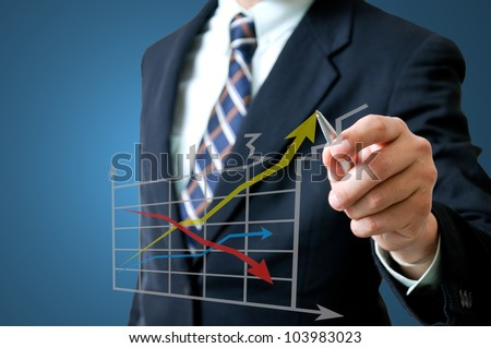 Business man with graph - stock photo