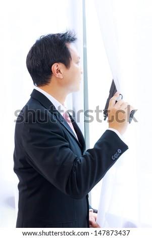 business man with gun - stock photo