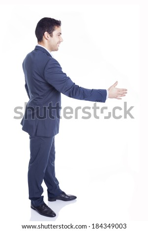 Business man with hand extended to handshake, isolated on white - stock photo