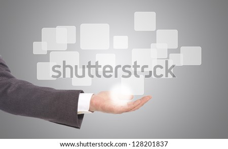 business man with hand pushing on a touch screen interface - stock photo