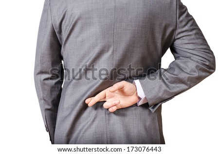 Business man with his fingers crossed behind his back - stock photo