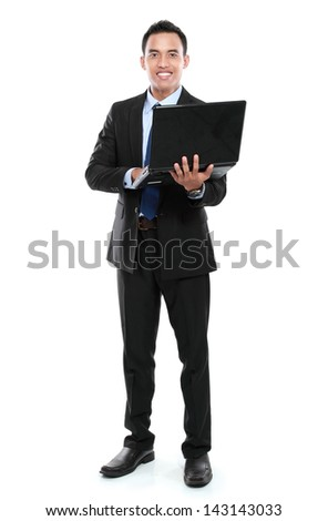 Business man with laptop looking at camera isolated on white background - stock photo