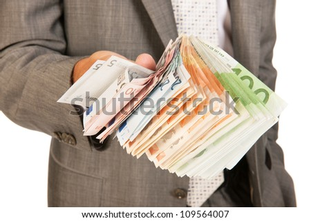Business man with lots of Euros in banknotes - stock photo