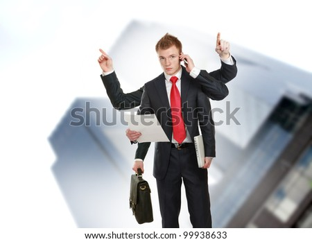Business man with many hands. - stock photo