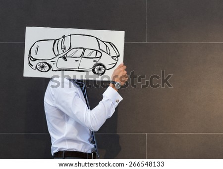 Business man with new car sign. Dealer or buyer showing car sign. Credit concept - stock photo