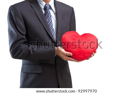 Business man with red heart isolated on white - stock photo