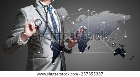 Business man with stethoscope, globalization business concept - stock photo