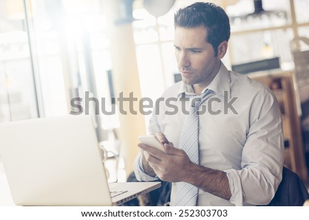 Business man with tablet computer - stock photo