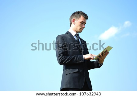 Business man with tablet on sky - stock photo