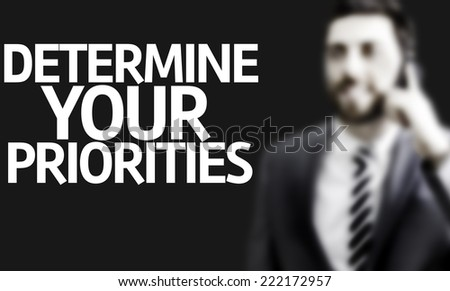 Business man with the text Determine your Priorities in a concept image - stock photo