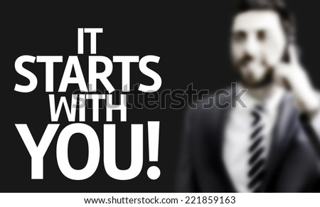 Business man with the text It Starts With You! in a concept image - stock photo