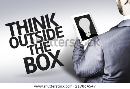 Business man with the text Think Outside the Box in a concept image - stock photo