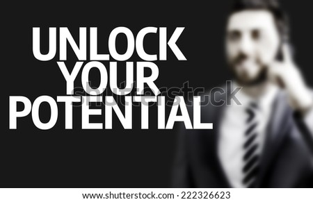 Business man with the text Unlock your Potential in a concept image - stock photo