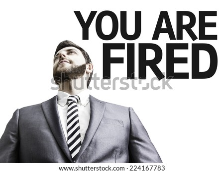 Business man with the text You Are Fired in a concept image - stock photo